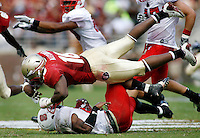 TALLAHASSEE, FL 10/31/09-FSU-NCST FB09 CH35-Florida State's Mister Alexander flattens N.C. State's Jamelle Eugene  during first half action Saturday at Doak Campbell Stadium in Tallahassee. .COLIN HACKLEY PHOTO