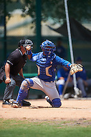 GCL Blue Jays catcher Manuel Herazo (9) throws the ball back in front of umpire Scott Molloy during a game against the GCL Braves on August 5, 2016 at ESPN Wide World of Sports in Orlando, Florida.  GCL Braves defeated the GCL Blue Jays 9-0.  (Mike Janes/Four Seam Images)