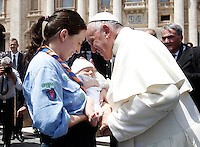 Papa Francesco saluta un bambino al termine dell'incontro con gli scout dell'Agesci in Piazza San Pietro, Citta' del Vaticano, 13 giugno 2015.<br /> Pope Francis greets a baby at the end of a meeting with Italian AGESCI boy scout association's members in St. Peter's Square at the Vatican, 13 June 2015.<br /> UPDATE IMAGES PRESS/Isabella Bonotto<br /> <br /> STRICTLY ONLY FOR EDITORIAL USE