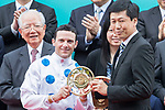 Jockey Brett Prebble receives a trophy after his horse Contentment won the Champions Mile (1600m) on 07 May 2017, at the Sha Tin Racecourse  in Hong Kong, China. Photo by Chris Wong / Power Sport Images
