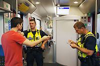 Switzerland. Canton Ticino. Stabio. Two police officers from TPO (Transport Police) are controlling the train tickets' validity of passengers travelling in the morning on a TILO train. The commuter (L) receives a fine for the lack of a proper ticket or a train subscription..TPO (Transport Police) is the Swiss Federal Railways Police. Swiss Federal Railways (German: Schweizerische Bundesbahnen (SBB), French: Chemins de fer fédéraux suisses (CFF), Italian: Ferrovie federali svizzere (FFS)) is the national railway company of Switzerland. It is usually referred to by the initials of its German, French and Italian names, as SBB CFF FFS. TILO (Treni Regionali Ticino Lombardia) creates efficient train connections between the towns in the canton Ticino.12.06.2017 © 2017 Didier Ruef