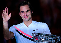 Roger Federer of Switzerland with the winners trophy on Day 14 of the Australian Open