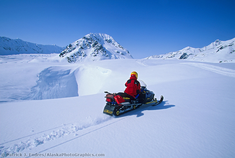 Snow machine riding on the canwell glacier in the Alaska Range mountains