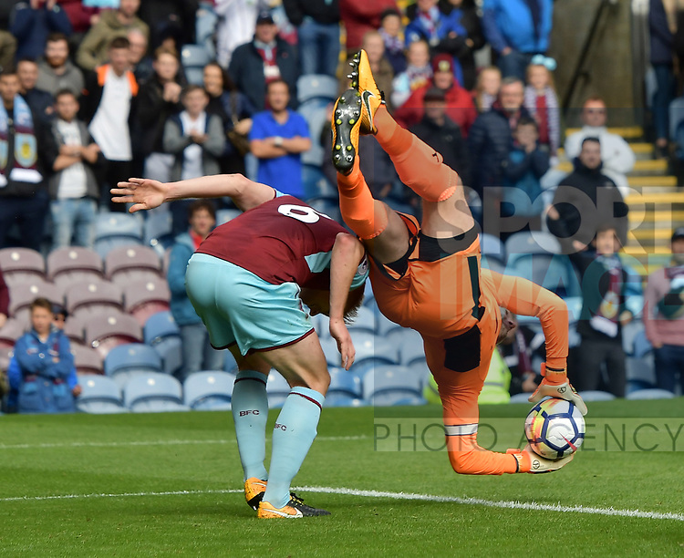 Burnley's Thomas Heaton collides with Burnley's Ben Mee<br /> during the premier league match at the Turf Moor Stadium, Burnley. Picture date 10th September 2017. Picture credit should read: Paul Burrows/Sportimage