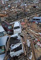 Cars are piled up at an intersection in the town town of Natori after the Tsunami devastated ahe entire pacifc coastline of Japan after the earthquake and tsunami devastated the area Sendai, Japan.<br /><br />photo by Richard Jones/ sinopix