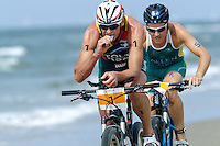 13 JUL 2013 - DEN HAAG, NED - Conrad Stoltz (RSA) (left) of South Africa leads Ben Allen (AUS) (right) of Australia on the bike as he races along the beach at the 2013 ITU Elite Men's Cross Triathlon World Championships in Kijkduin, Den Haag (The Hague), the Netherlands (PHOTO COPYRIGHT © 2013 NIGEL FARROW, ALL RIGHTS RESERVED)
