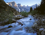 Banff National Park, Alberta, Canada    <br /> Swift waters of Moraine Creek flowing from Moraine Lake under the Wenkchemna Peaks of the Canadian Rockies
