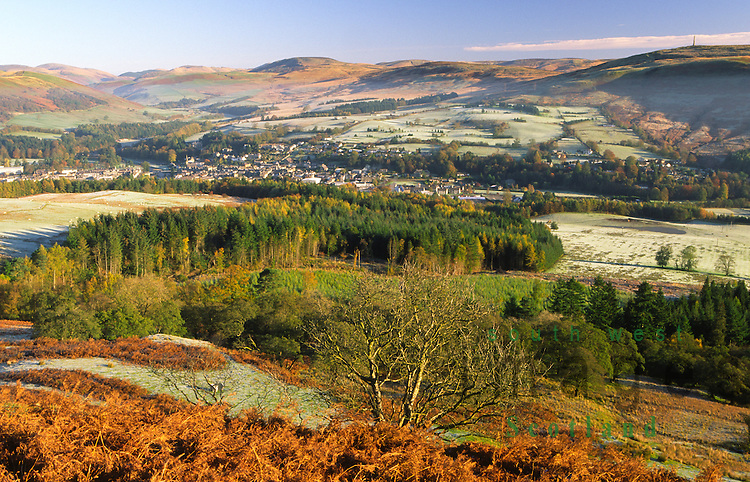 Looking down on a autumnal Langholm nestled in between the rolling border hills Eskdale Dumfriesshire Scotland UK