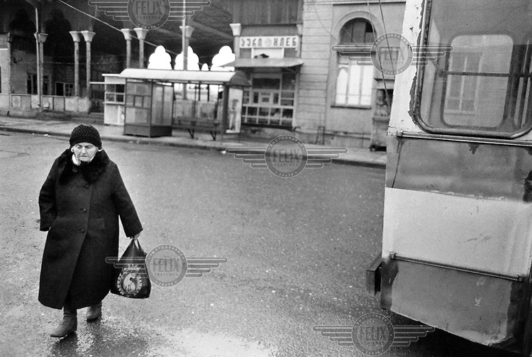 An elderly woman outside the local train station in the Caucasus region.
