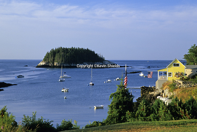Harbor scene at Five Islands, Georgetown, Maine, USA, showing boats, islands and the Atlantic Ocean.