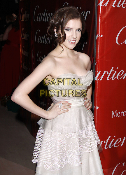 ANNA KENDRICK.The 21st Annual Palm Springs International Film Festival held at The Civic Center in Palm Springs, California, USA. .January 5th, 2010.half length dress hands on hips strapless white cream peplum.CAP/RKE/DVS.©DVS/RockinExposures/Capital Pictures.