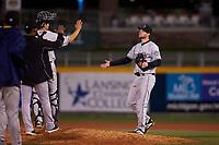 Wisconsin Timber Rattlers relief pitcher Robbie Hits (17) is congratulated by teammates after a Midwest League game against the Lansing Lugnuts at Cooley Law School Stadium on May 1, 2019 in Lansing, Michigan. Wisconsin defeated Lansing 2-1 in the second game of a doubleheader. (Zachary Lucy/Four Seam Images)