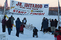 Jimmy Lanier crosses the finish line of the 2014 Jr. Iditarod Sled Dog Race at Happy Trails Kennel, Big Lake, Alaska<br /> Sunday February 23, 2014 <br /> <br /> Junior Iditarod Sled Dog Race 2014<br /> PHOTO BY JEFF SCHULTZ/IDITARODPHOTOS.COM  USE ONLY WITH PERMISSION