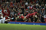 Wales number 8 Taulupe Faletau leaves Waisea Nayacalevu trailing as he dives over the try line only for the try to be disallowed.<br /> Dove Men Series 2014<br /> Wales v Fiji<br /> Millennium Stadium<br /> 15.11.14<br /> ©Steve Pope-SPORTINGWALES