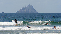3-8-2014: Holidaymakers enjoy some pleasant surfing  at St. Finan's Bay with Skellig Michael in the background in County kerry on Sunday.<br /> Picture by Don MacMonagle