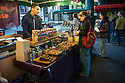 London, UK. 15.11.2014. A young woman buys fudge from a stall at Borough Market. Photograph © Jane Hobson.