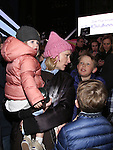Cate Blanchett and family attend The Ghostlight Project to light a light and make a pledge to stand for and protect the values of inclusion, participation, and compassion for everyone - regardless of race, class, religion, country of origin, immigration status, (dis)ability, gender identity, or sexual orientation at The TKTS Stairs on January 19, 2017 in New York City.
