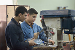 Two young men use a drill press in a metalworking class in the Vocational Training Center in Gaza City, Gaza. The center is run by the Department of Service for Palestinian Refugees of the Near East Council of Churches, a member of the ACT Alliance, and funded in part by the Pontifical Mission for Palestine.