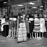 A man named Sisko tries on a skirt outside Fabulous Fashions in Joubert Park.