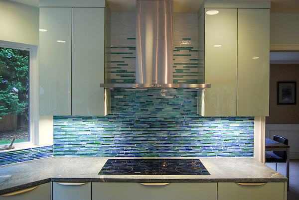 This custom kitchen backsplash features Mist, a handmade mosaic shown in blue, white and green 1.5cm jewel glass stalks from New Ravenna.<br /> -photo coutesy of Ambiente Tile<br /> <br /> For pricing samples and design help, click here: http://www.newravenna.com/showrooms/