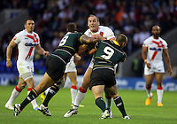 PICTURE BY VAUGHN RIDLEY/SWPIX.COM - Rugby League - 2013 International Origin - England v Exiles - Halliwell Jones Stadium, Warrington, England - 14/06/13 - England's Gareth Ellis is tackled by Exiles Tony Puletua and Heath L'Estrange.