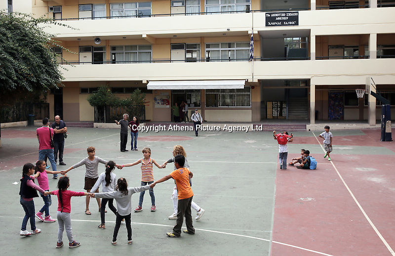 Pictured: Migrant and local children play in the yard of the Thissio 72nd Primary School of Athens Greece. Monday 10 October 2016<br /> Re: Children of refugees have started school in various parts of Greece.