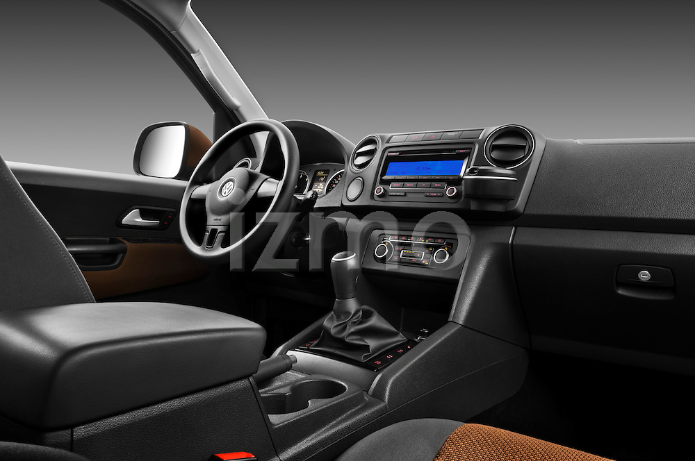 Passenger side dashboard view of a 2012 Volkswagen Amarok Trendline Truck.