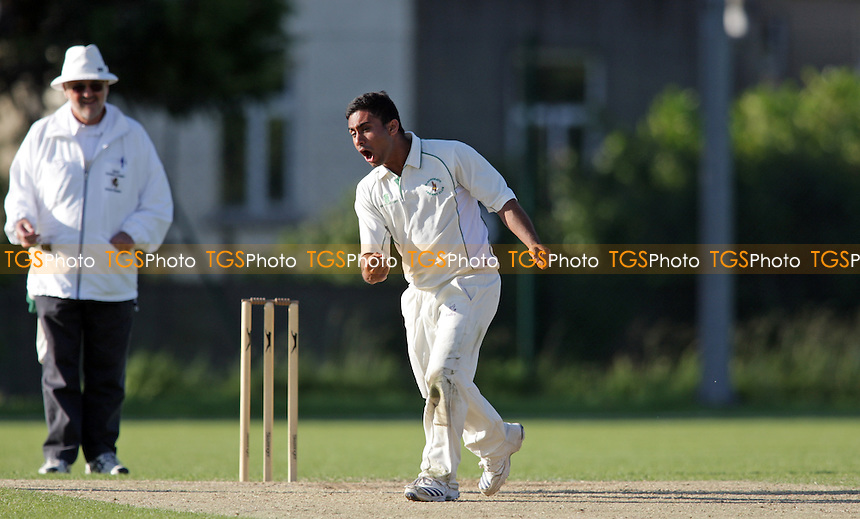 Mehdi Abbas of Blackheath CC celebrates his wicket of B. Hooper of Bickley Park CC - Blackheath CC vs Bickley Park CC - Kent Cricket League at Rectory Field - 09/06/12 - MANDATORY CREDIT: Helen Watson/TGSPHOTO - Self billing applies where appropriate - 0845 094 6026 - contact@tgsphoto.co.uk - NO UNPAID USE.