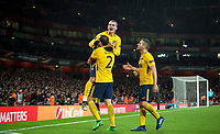 Diego Godín (2) lifts goal scorer Antoine Griezmann of Atletico Madrid to celebrate a late equaliser during the UEFA Europa League Semi Final 1st leg match between Arsenal and Atletico Madrid at the Emirates Stadium, London, England on 26 April 2018. Photo by Andy Aleksiejczuk / PRiME Media Images