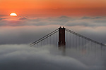 A rising sun peeked over a blanket of fog that overwhelmed the bay as  spring mild temperatures continue throughout the week.  3/8/05 San Francisco CA.