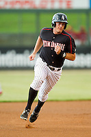 Jason Coats (17) of the Kannapolis Intimidators hustles towards third base against the Lakewood BlueClaws at CMC-Northeast Stadium on August 13, 2013 in Kannapolis, North Carolina.  The Intimidators defeated the BlueClaws 12-8.  (Brian Westerholt/Four Seam Images)