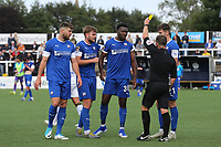 Referee Garreth Rhodes shows a yellow card to Chesterfield's Mike Fondop-Talom (No 36) after an altercation at the final whistle during Bromley vs Chesterfield, Vanarama National League Football at the H2T Group Stadium on 7th September 2019