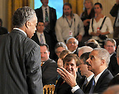 Washington, D.C. - May 26, 2009 -- Reverend Al Sharpton, left, shares some thoughts with United States Attorney General Eric Holder, lower right, as they await U.S. President Barack Obama's announcement naming Judge Sonia Sotomayor of the Federal Appeals Court as his nominee for Justice of the U.S. Supreme Court in the East Room of the White House on Tuesday, May 26, 2009.  She will replace retiring Justice David Souter. Judge Sotomayor, 54, of The Bronx, New York, will be the first Hispanic to serve if her nomination is approved by the U.S. Senate.  .Credit: Ron Sachs / Pool via CNP