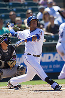 Round Rock third baseman Yangervis Solarte (26) follows through on his swing against the Nashville Sounds in the Pacific Coast League baseball game on May 5, 2013 at the Dell Diamond in Round Rock, Texas. Round Rock defeated Nashville 5-1. (Andrew Woolley/Four Seam Images).