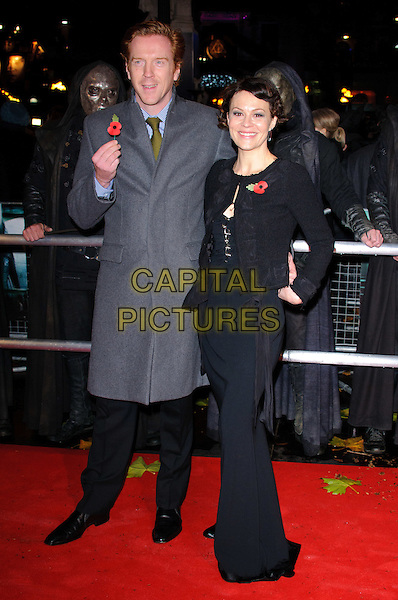 """DAMIAN  LEWIS & HELEN McCRORY.""""Harry Potter And The Deathly Hallows: Part 1"""" World Film Premiere, Empire cinema Leicester Square and Odeon Leicester Square, London, England, UK, 11th November 2010..full length black grey gray coat tie couple long maxi dress husband wife poppy jacket .CAP/CJ.©Chris Joseph/Capital Pictures."""