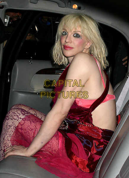 COURTNEY LOVE.leaves her apartment to perform in concert at the Bowery Ballroom in New York City. .18 March 2004.*UK Sales Only*.red dress, car, cab, taxi.www.capitalpictures.com.sales@capitalpictures.com.©Capital Pictures.