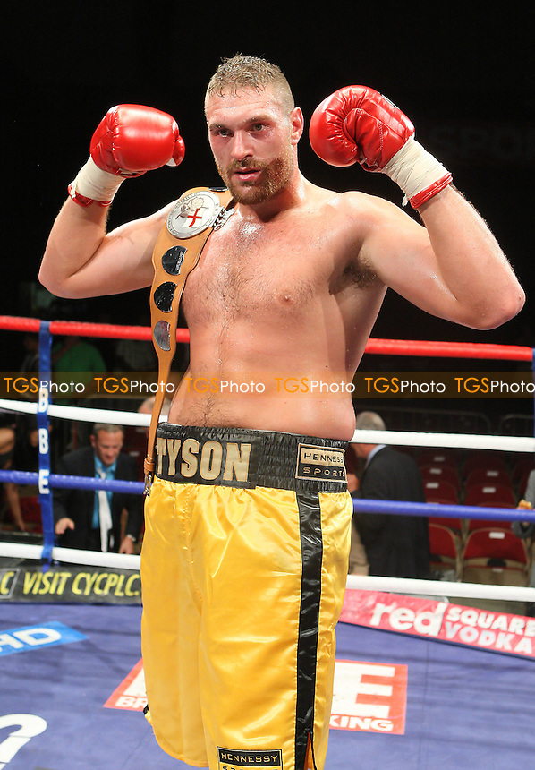 Tyson Fury (gold shorts) defeats John McDermott to win the English Heavyweight Boxing Title at the Brentwood Centre, Essex, promoted by Frank Maloney / FTM Sports -  25/06/10 - MANDATORY CREDIT: Gavin Ellis/TGSPHOTO - Self billing applies where appropriate - Tel: 0845 094 6026