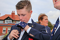 Conor Purcell  (GB&I) doing his best to tie the team USA tie during the opening ceremony at the Walker Cup, Royal Liverpool Golf CLub, Hoylake, Cheshire, England. 06/09/2019.<br /> Picture Fran Caffrey / Golffile.ie<br /> <br /> All photo usage must carry mandatory copyright credit (© Golffile | Fran Caffrey)