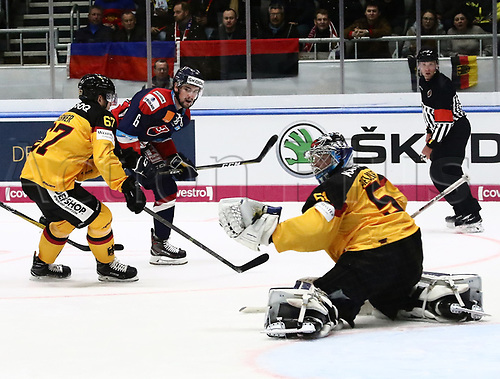 11th November 2017, Curt Frenzel Stadium, Augsburg, Germany; 2017 Deutschland Cup, Germany versus Slovakia; from left Eberhard EBNER (Germany) challenges as  Lukas CINGEL (Slovakia) sees his shot saved by Timo PIELMEIER (Germany)