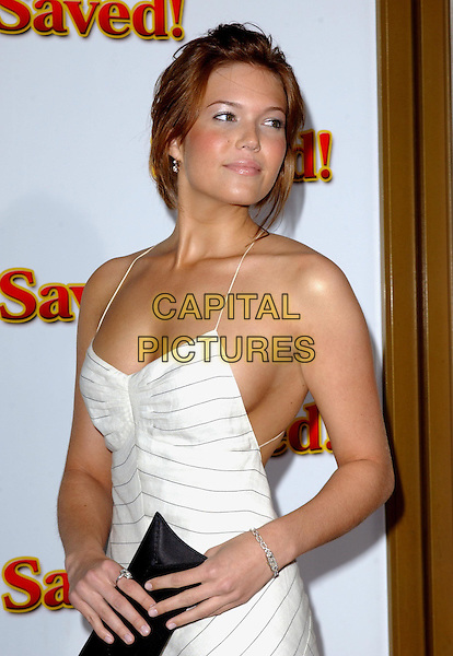 "MANDY MOORE.At the United Artists' World Premiere of ""Saved!"" at the Mann National Theatre, .Westwood, California,.May 13,2004.half length half-length long white pinstripe dress low back spagetti strap black clutch bag tan.*UK sales only*.www.capitalpictures.com.sales@capitalpictures.com.©Debbie Van Story/Capital Pictures"
