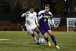 20 November 2014: James Madison's Josh Grant (ENG) (11) and North Carolina's Omar Holness (JAM) (14). The University of North Carolina Tar Heels hosted the James Madison University Dukes at Fetzer Field in Chapel Hill, NC in a 2014 NCAA Division I Men's Soccer Tournament First Round match. UNC won the game 6-0.