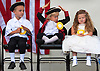 """Unhappy Patriots"".Noah Keenan, 5, Aedan Gilman,5, and Shealee McCulla, 5, all are lost in their own thoughts as they wait for their turn to speak during the Little Miss Stafford/ Little Town Crier Pageant at Stafford Founders Day.  06/12/10"