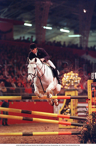 JOHN WHITAKER on Everest Randi at the OLYMPIA Horse Show, Showjumping. 9411. Photo: Steve Bardens/Action Plus...1994.equestrian.showjumping showjumper.showjumpers.equestrian sport sports.man.male