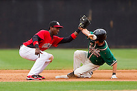 Shortstop Jurickson Profar #10 of the Hickory Crawdads applies a late tag as Daniel Black #18 of the Greensboro Grasshoppers steals second base at L.P. Frans Stadium on May 18, 2011 in Hickory, North Carolina.   Photo by Brian Westerholt / Four Seam Images