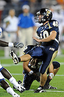 11 October 2008:  FIU kicker Dustin Rivest (40) kicks a field goal in the FIU 31-21 victory over Middle Tennessee at FIU Stadium in Miami, Florida.