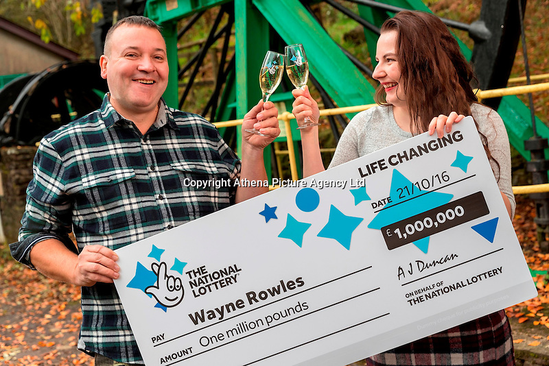 ictured L-R: £1million winner Wayne Rowles with daughter Laura<br /> Re: A full-time carer from Port Talbot is celebrating after winning a life-changing £1,000,000 on the EuroMillions UK Millionaire Maker.<br /> Wayne Rowles, 45, spends much of his time looking after his 82 year old father and a couple of his elderly friends. Last Friday he popped out to buy each of them a paper when he decided to try his luck on the EuroMillions.<br /> The next morning he had some rare time alone and decided to check Friday night's (21 October) EuroMillions results on his television's red button.