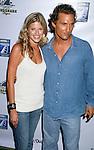 "MALIBU, CA. - September 10: Actress Sarah Wright and Producer/Actor Matthew McConaughey arrive at the ""Surfer Dude"" premiere at the Malibu Cinemas on September 10, 2008 in Malibu, California."