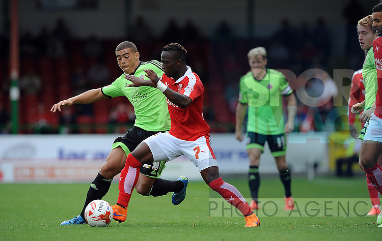 Drissa Traore of Swindon Town is challenged by Che Adams of Sheffield United<br /> - English League One - Swindon Town vs Sheffield Utd - County Ground Stadium - Swindon - England - 29th August 2015