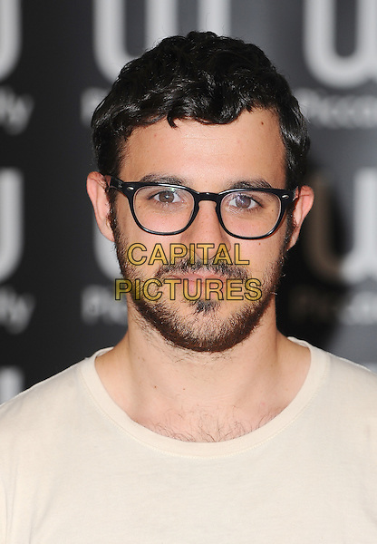 Simon Bird.Stars from the E4 award-winning comedy series, sign copies of The Inbetweeners Yearbook, Waterstones Piccadilly, London, England..29th September 2011.headshot portrait beard facial hair glasses white.CAP/BEL.©Tom Belcher/Capital Pictures.
