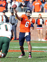 Oct 30, 2010; Charlottesville, VA, USA;   DUPLICATE***Virginia Cavaliers kicker Drew Jarrett (6)***Virginia Cavaliers quarterback Marc Verica (6) throws the ball during the game against the Miami Hurricanes at Scott Stadium. Virginia won 24-19. Mandatory Credit: Andrew Shurtleff